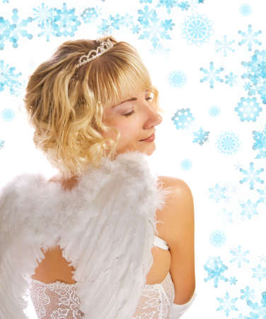 Blond angel girl and abstract snowflakes around her photo