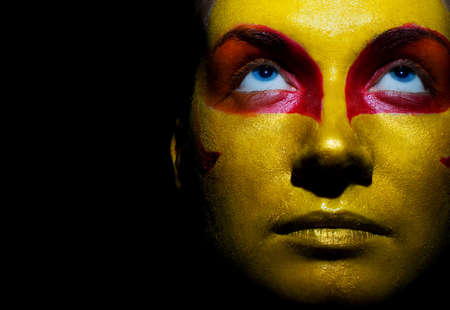 Portrait of a mysteus woman with artistic make-up on her face. Isolated on black background Stock Photo - 2262072