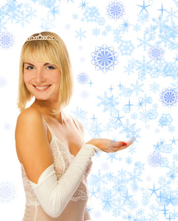 Beautiful princess with her hand outstretched, as though she is presenting something. Perfect place to put text of object photo