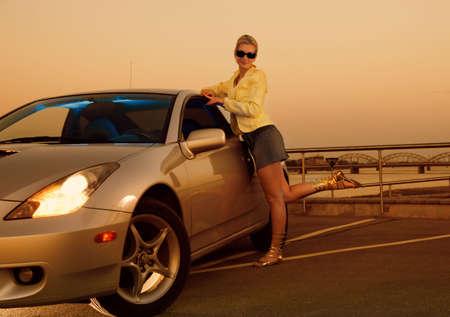 Sexy girl near the modern sport car photo