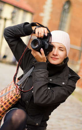 photography session: Beautiful girl with a digital camera