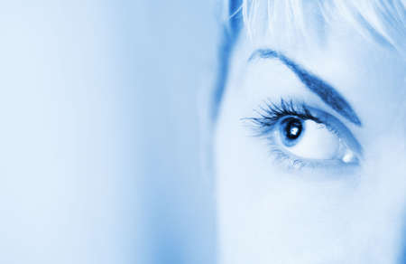 shinning light: Human eye toned in blue Stock Photo