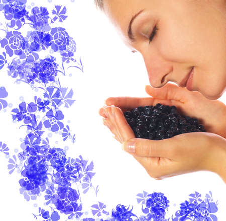 punhado: Beautiful girl with a handful of blueberries Banco de Imagens