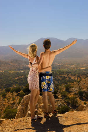 the majesty: An attractive couple relaxing in high mountains Stock Photo