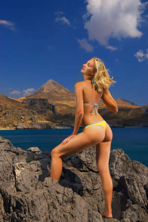 Beautiful blond girl relaxing in mountains near the sea Stock Photo - 2272041