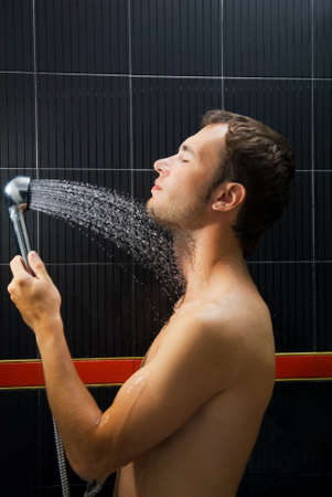 Young handsome man in a shower photo