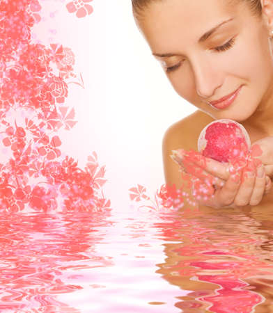 Beautiful girl with aroma bath ball in rendered water photo