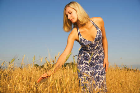 Beautiful blond girl in the field photo