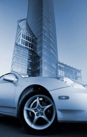 Picture of a modern sport car in front of office building (toned in blue) photo