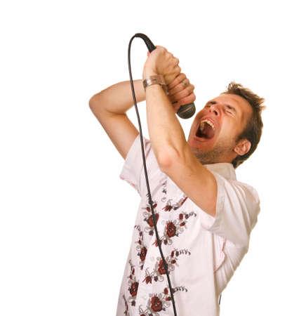 jeune mec: Jeune homme avec un microphone sur blanc backrgound