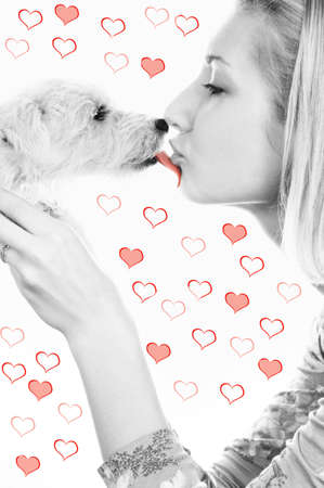 Blond girl with a sweet puppy on abstract heart background Stock Photo - 2282309