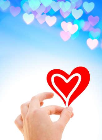 corazon en la mano: Mano con un coraz�n  Foto de archivo
