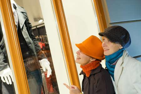 Two girls near the shop window photo