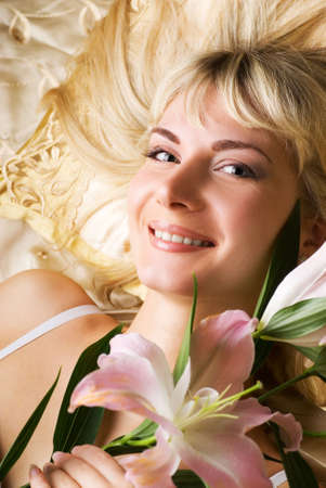 Happy young woman with pink lily photo