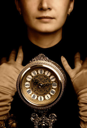 Sepia portrait of a girl with a clock photo