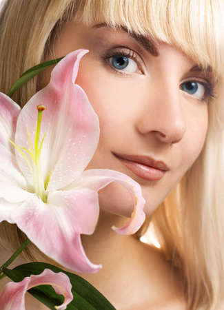 Beautuful woman with pink lily Stock Photo - 2421726