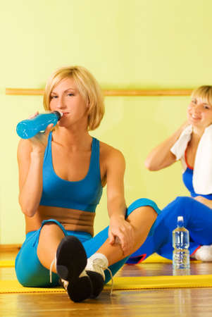 isotonic: Beautiful women relaxing after fitness exercise