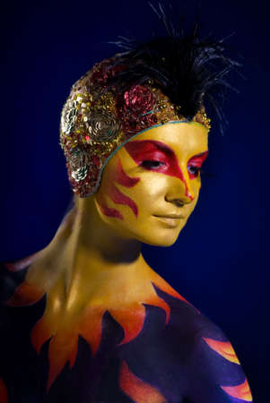 Portrait of a mysteus woman with artistic make-up on her body Stock Photo - 2470810