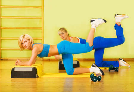 fitness club: Beautiful women exercising in fitness club Stock Photo
