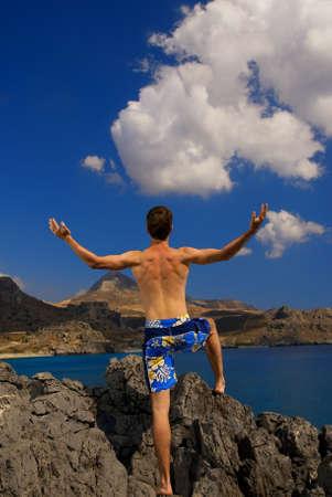 Discoverer on a mountain photo