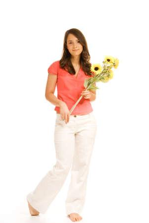 Beautiful teenage girl holding bunch of sunflowers isolated on white background photo