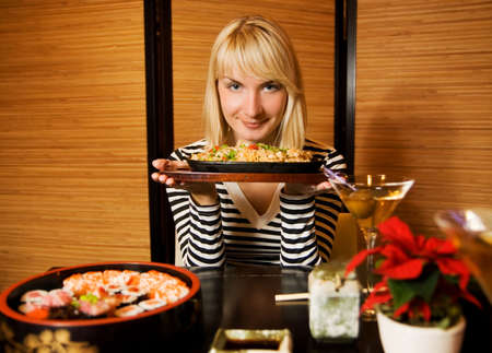 Beautiful young woman in a restaurant photo