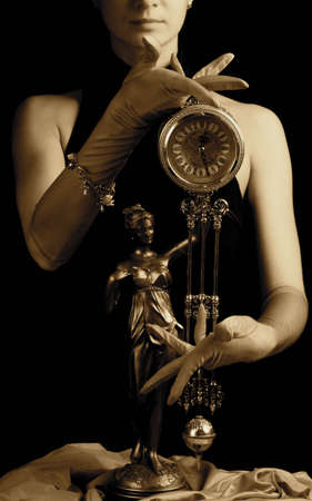 Sepia picture of a clock and beautiful young girl (focus on clock) photo