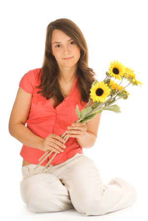 Beautiful teenage girl holding bunch of sunflowers isolated on white background photo