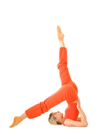 supported: Beautiful young woman doing supported shoulderstand isolated on white background Stock Photo
