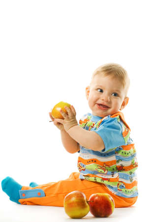 Adorable baby with fresh apples isolated on white background photo