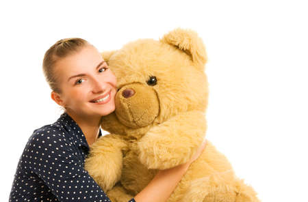 Beutiful young happy woman with big teddy bear toy photo