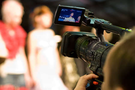 video production: Cameraman with digital video camera Stock Photo