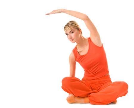 Beautiful young woman doing yoga exercise isolated on white background Stock Photo - 2641808