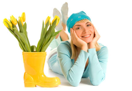 Beautiful teenage girl with yellow tulips isolated on white background photo