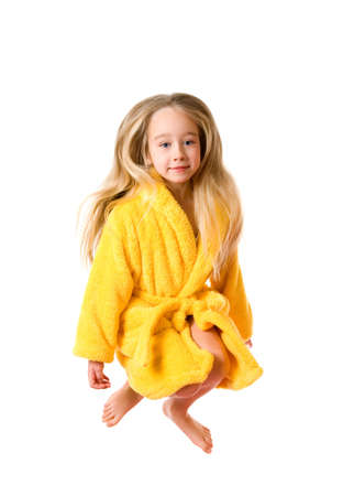 Funny jumping girl in a bathrobe isolated on white background Stock Photo - 2671912