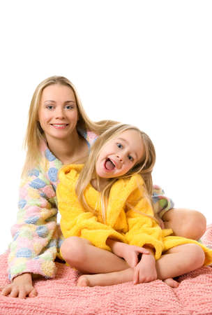 Mother and her daughter sitting on a bed Stock Photo - 2671922