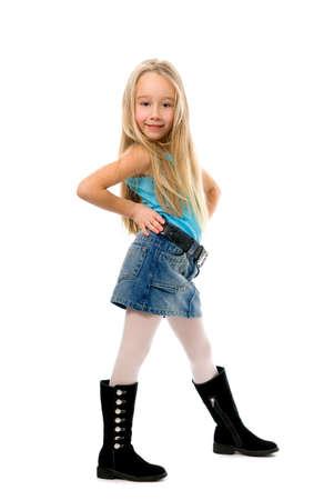 long skirt: Little funny girl posing over white background