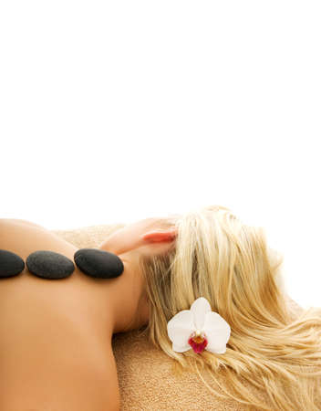 volcanic: Massage with hot volcanic stones Stock Photo