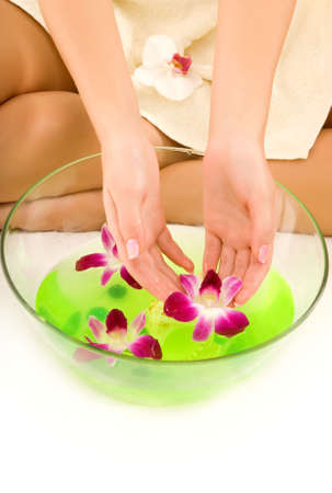 Girl washing hands in aroma water photo