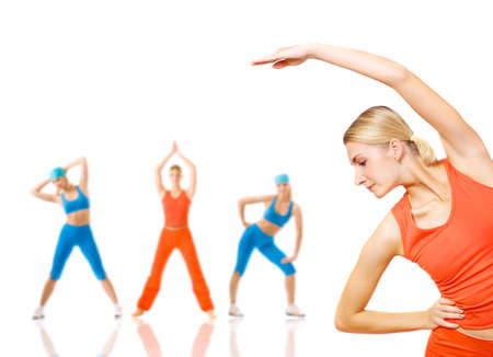 Group of women doing fitness exercise isolated on white. Lots of possibilities to put your text on photo
