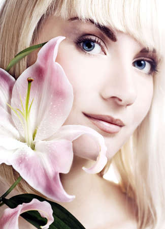 Beautuful woman with pink lily high-key portrait Stock Photo - 2718380