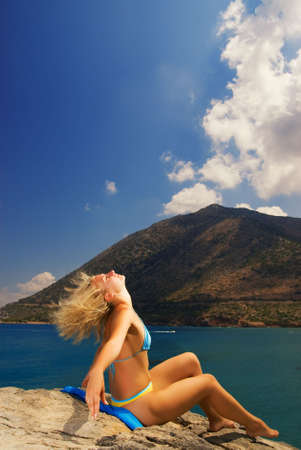Beautiful girl relaxing near the sea Stock Photo - 2717967