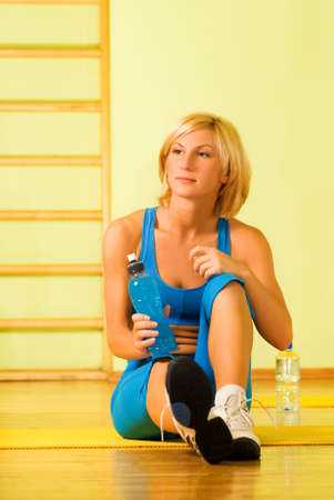 isotonic: Beautiful woman relaxing after fitness exercise