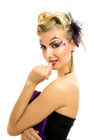 Beautiful woman in fashionable dress with creative hairstyle and makeup photo