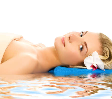 Beautiful young woman ready for spa threatment near the water photo