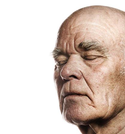 Anciano en la cara más de fondo blanco  Foto de archivo