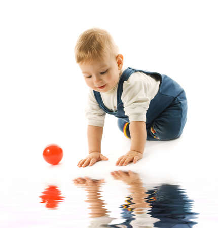 Adorable  looking at his reflection in water photo