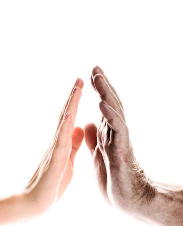 Hands of young woman and elderly man over white background Stock Photo - 2799618