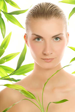 bodycare: Beautiful young woman with a bamboo plant