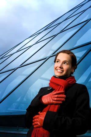 Beautiful dreaming young woman near modern building Stock Photo - 2837213